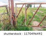 closeup of a rusty iron gate... | Shutterstock . vector #1170496492