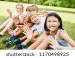 Small photo of Multicultural kids having fun and waving as friends