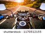 biker driving a motorcycle... | Shutterstock . vector #1170512155