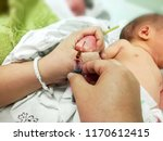 closeup hands of pediatric... | Shutterstock . vector #1170612415