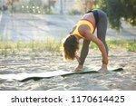 young woman in sportswear...   Shutterstock . vector #1170614425