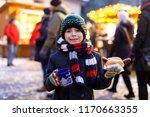 little cute kid boy eating... | Shutterstock . vector #1170663355