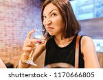 a woman at the tasting tries...   Shutterstock . vector #1170666805