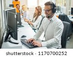 happy young customer service... | Shutterstock . vector #1170700252