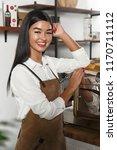 girl barista brews coffee | Shutterstock . vector #1170711112