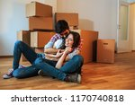 young couple moving into a new... | Shutterstock . vector #1170740818