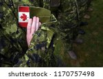 canada patch flag on soldiers... | Shutterstock . vector #1170757498