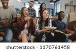 mixed ethnicity group watching... | Shutterstock . vector #1170761458