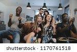 multi ethnic fans go crazy... | Shutterstock . vector #1170761518