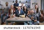 friends watch sports on tv ...   Shutterstock . vector #1170761545