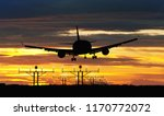 silhouette airplane during...   Shutterstock . vector #1170772072
