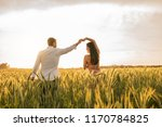 romantic couple dancing on love ... | Shutterstock . vector #1170784825