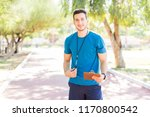 young running coach holding... | Shutterstock . vector #1170800542