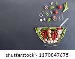 vegetables falling into a bowl... | Shutterstock . vector #1170847675