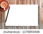 coffee cup and black pencil on... | Shutterstock . vector #1170853408