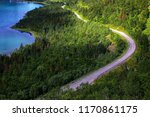 road in forest and remote sea... | Shutterstock . vector #1170861175