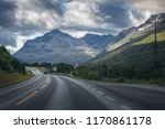 car on road in norway. clouds... | Shutterstock . vector #1170861178