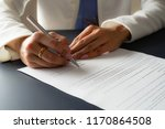 female hand signing contract. | Shutterstock . vector #1170864508