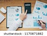 businessman working on a graph... | Shutterstock . vector #1170871882