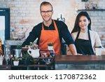 portrait of happy shop partners ... | Shutterstock . vector #1170872362