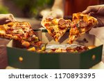 close up of sliced hot pizza... | Shutterstock . vector #1170893395