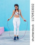 latin woman working out in... | Shutterstock . vector #1170923032