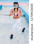 latin woman working out in... | Shutterstock . vector #1170923035