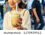 Woman Drinks Pearl Milk Tea At...