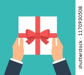 give gift. man holds white gift ... | Shutterstock . vector #1170930508