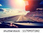 driving a car on mountain... | Shutterstock . vector #1170937282