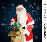 smiling santa claus delivers... | Shutterstock . vector #1170941818