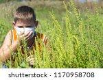 boy sneezes because of an... | Shutterstock . vector #1170958708
