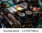 Stock photo shamanic table candles and herbs for rituals close up of religious accessories fit for rituals 1170974812