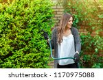 smiling young woman with garden ... | Shutterstock . vector #1170975088