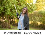 smiling young woman with garden ... | Shutterstock . vector #1170975295