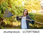 smiling young woman with garden ... | Shutterstock . vector #1170975865