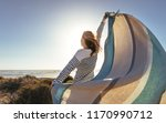 rear view of a woman standing...   Shutterstock . vector #1170990712