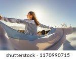 woman standing facing the sea...   Shutterstock . vector #1170990715