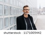 trendy middle aged man deep in... | Shutterstock . vector #1171005442