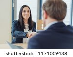 smiling businesswoman shaking... | Shutterstock . vector #1171009438