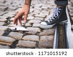 smartphone fell on a cobbled... | Shutterstock . vector #1171015192