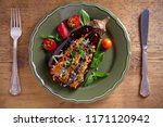 baked eggplant  stuffed with... | Shutterstock . vector #1171120942