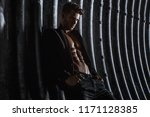 muscular young man with beard... | Shutterstock . vector #1171128385