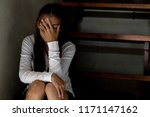 a woman sitting alone and... | Shutterstock . vector #1171147162