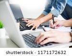 asian team outsource developer... | Shutterstock . vector #1171172632
