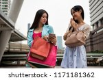 angry shopaholic girl blame her ... | Shutterstock . vector #1171181362