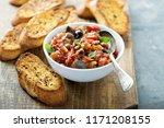 eggplant caponata crostini or... | Shutterstock . vector #1171208155