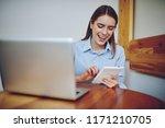 cheerful smiling hipster girl... | Shutterstock . vector #1171210705
