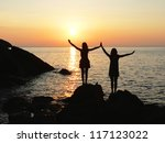 Two Silhouette Girls Standing...