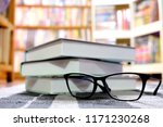 glasses and books placed at the ... | Shutterstock . vector #1171230268